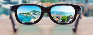 cityscape_focused_in_glasses_1280x480 300x113_compressed